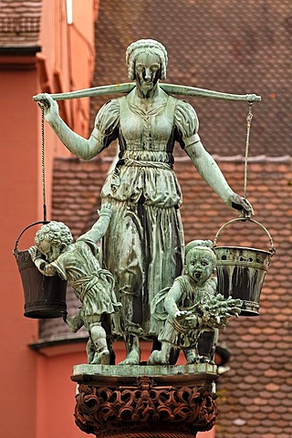 Water carrier with children as figures on the fountain, donated in 1911 by the merchant Ludwig Rau, Kartoffelmarkt square, Freiburg, Baden-Wuerttemberg, Germany, Europe