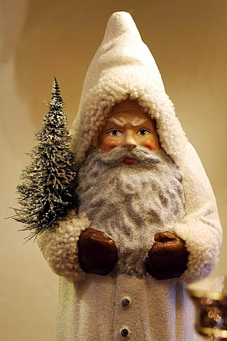 Santa Claus figure, detail, with a snow-covered fir tree in his hand, Villa Ambiente, Im Weller, Nuremberg, Middle Franconia, Bavaria, Germany, Europe