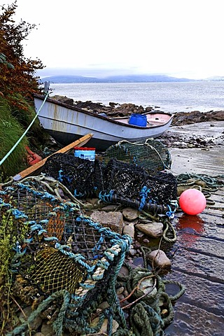 Dinghy and lobster pots on boat ramp, Ring of Kerry, County Kerry, Ireland, Europe