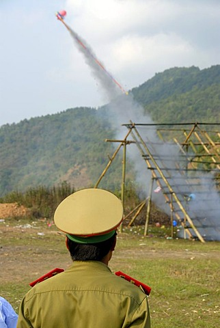 Laotian pi mai New Year festival, launch of a rocket, bang fai rocket firing, policeman with a peaked cap, Phongsali, Laos, Southeast Asia, Asia