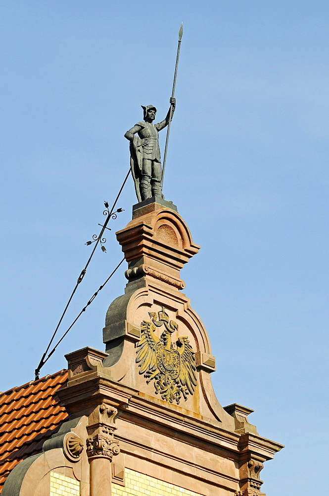 Statue of a Knight holding a lance above an eagle crest, historic building, historic town centre, Herford, Eastern Westphalia, North Rhine-Westphalia, Germany, Europe