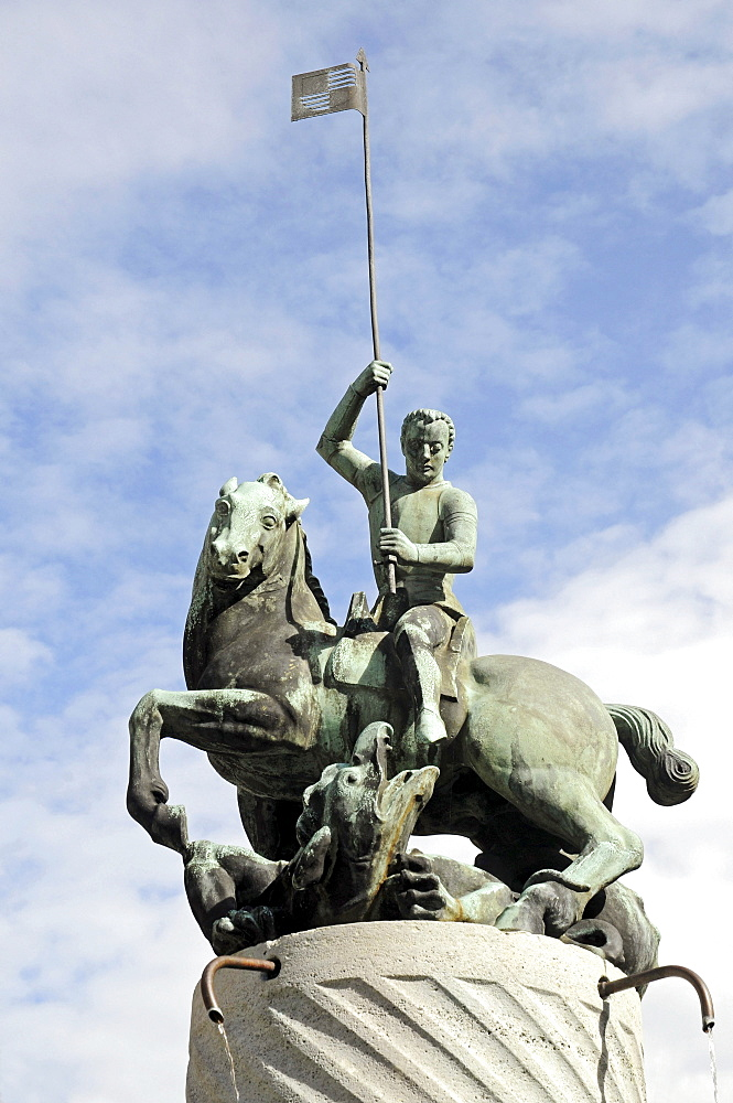 St. George Fountain, equestrian sculpture, horse and rider with a lance, War Memorial, Town Hall Square, Ahaus, Muensterland, North Rhine-Westphalia, Germany, Europe