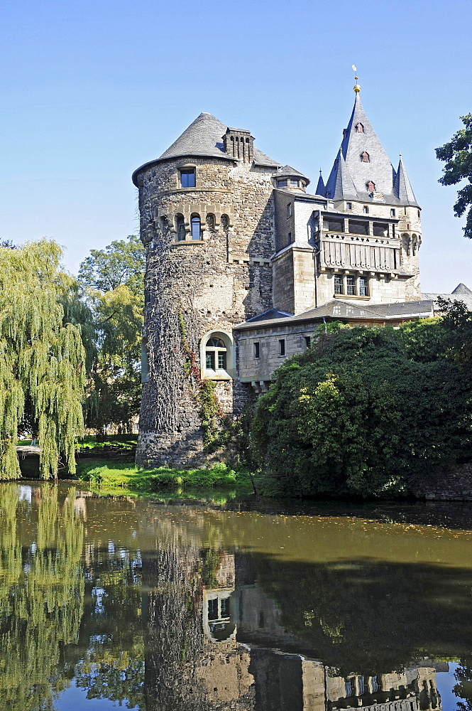 Schloss Huelchrath Castle and park, moated castle reflected in water, Grevenbroich, Lower Rhine, North Rhine-Westphalia, Germany, Europe