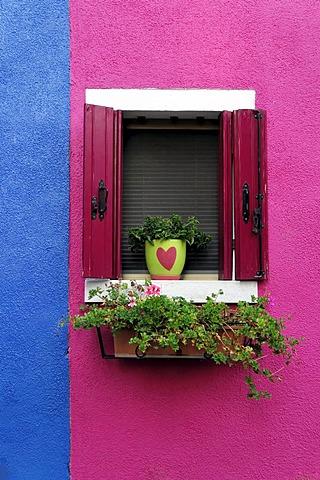 Coloured house facade with a beautifully decorated window, Burano, Venice, Veneto, Italy, Europe