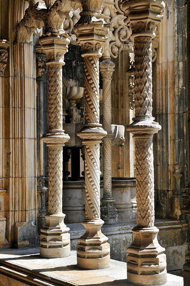 Richly decorated columns in the cloister of the Dominican monastery Mosteiro de Santa Maria da Vitoria, UNESCO World Heritage Site, Batalha, Portugal, Europe