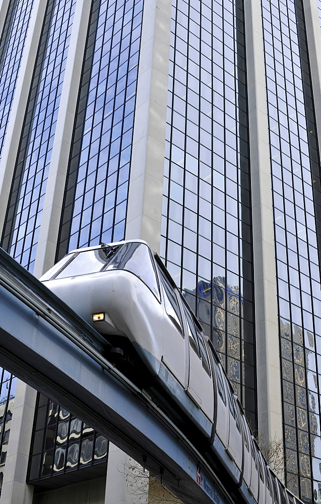 Monorail passing a high-rise building, Central Business District, Sydney, New South Wales, Australia