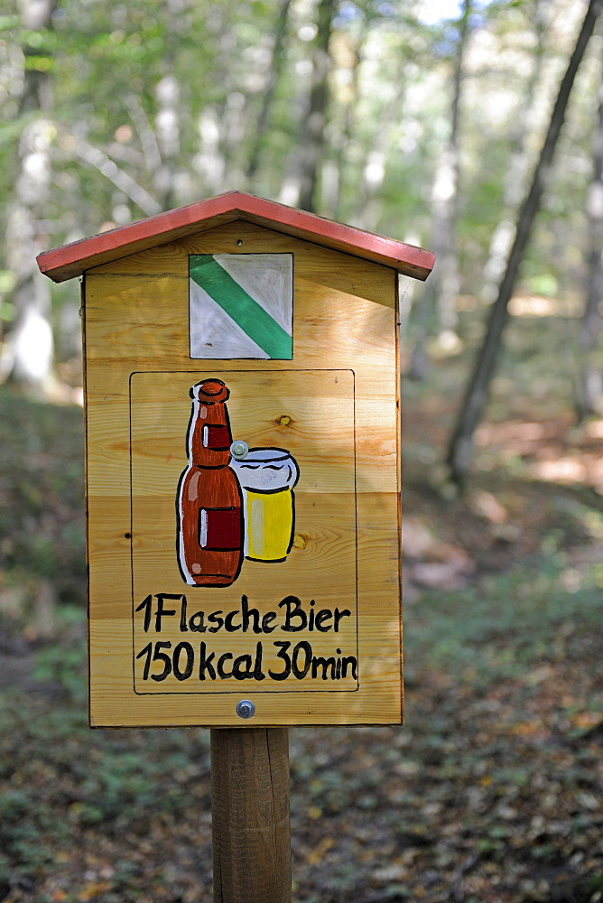 Sign on a hiking trail, shows the amount of time you need to walk off a beer