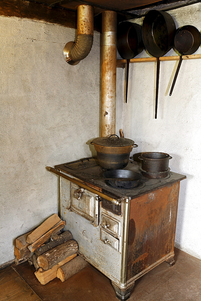 Old stove with an oven pipe, kitchen, historic bakery from 1730, Wolfegg Farmhouse Museum, Allgaeu, Upper Swabia, Baden-Wuerttemberg, Germany, Europe