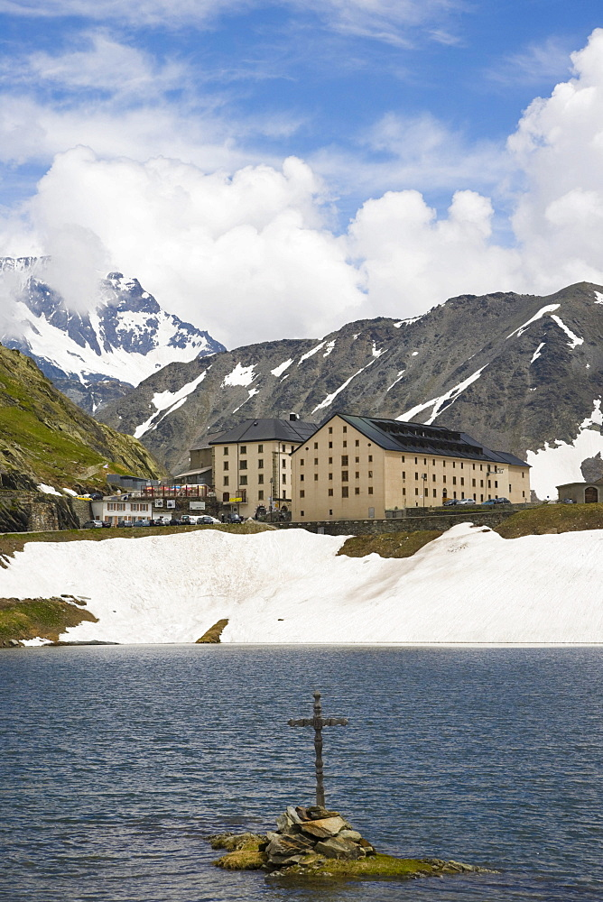 View of Hospice du Grand-Saint-Bernard across the lake, Great St Bernard Pass, Col du Grand-Saint-Bernard, Colle del Gran San Bernardo, Western Alps, Italy, Europe
