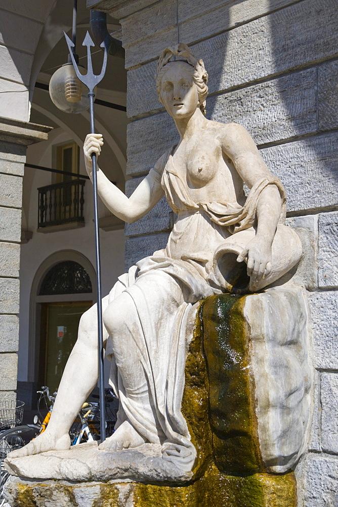 Statue of Dora Baltea on the portico of Hotel de Ville, town hall, Piazza Emile Chanoux, Aosta, Aosta Valley, Valle d'Aosta, Italy, Europe