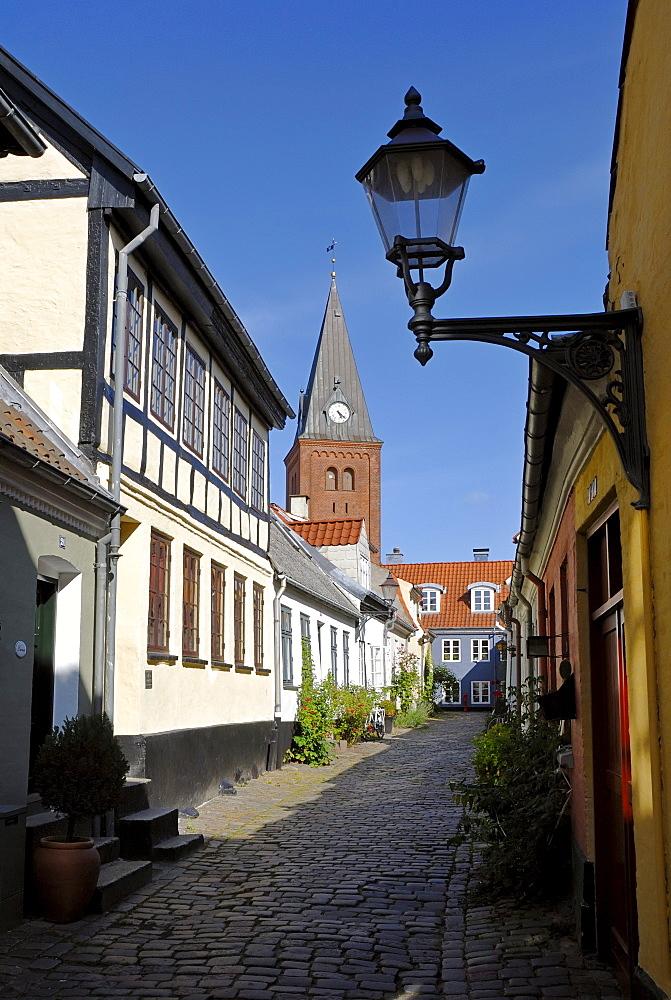 Cobblestone street in the historic town of Aalborg, ≈lborg, in the back the Frue Kirke church, Nordjylland region, Denmark, Scandinavia, Europe