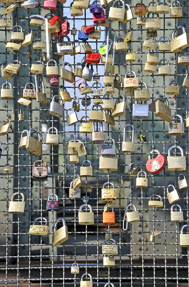 Padlocks as a sign of friendship and love at the metal fence of the Hohenzollernbruecke Hohenzollern Bridge in Cologne, North Rhine-Westphalia, Germany, Europe