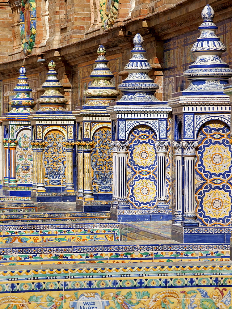 Colourful ceramic tiles displaying scenes from the Spanish regions, Plaza de Espagna, Seville, Andalusia, Spain, Europe