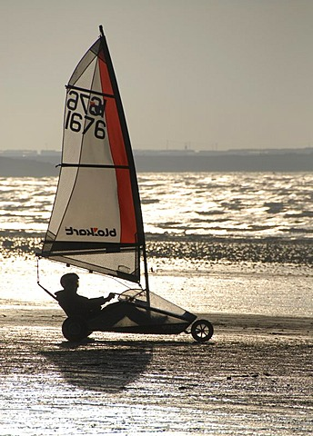 Person in sail wagon on the beach, silhouette, land sailing, sand yachting, Weston super Mare, Somerset, England, Great Britain, Europe