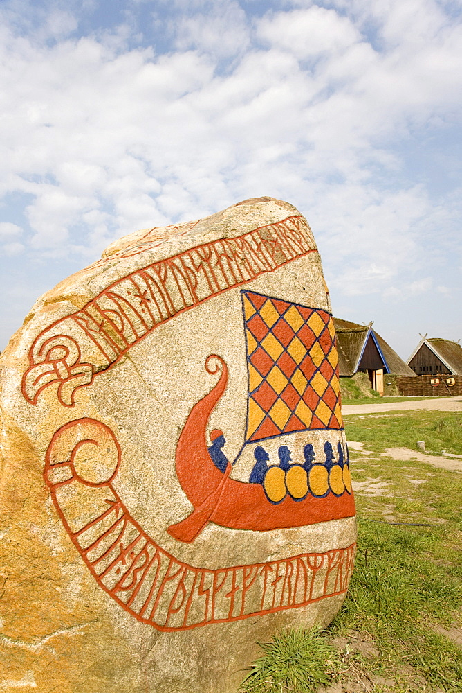 Inscription and a Viking boat on a rune stone, at the Viking Museum in Bork on Ringkoebing Fjord, West Jutland, Denmark, Europe