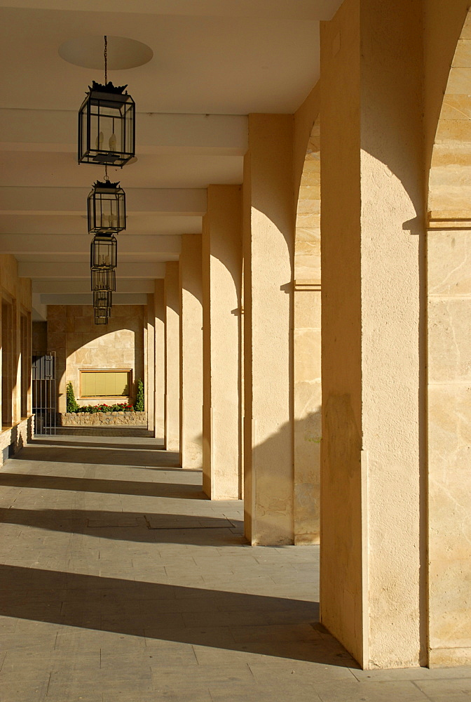 An arcade in soft early morning light, Ronda, Andalusia, Spain, Europe