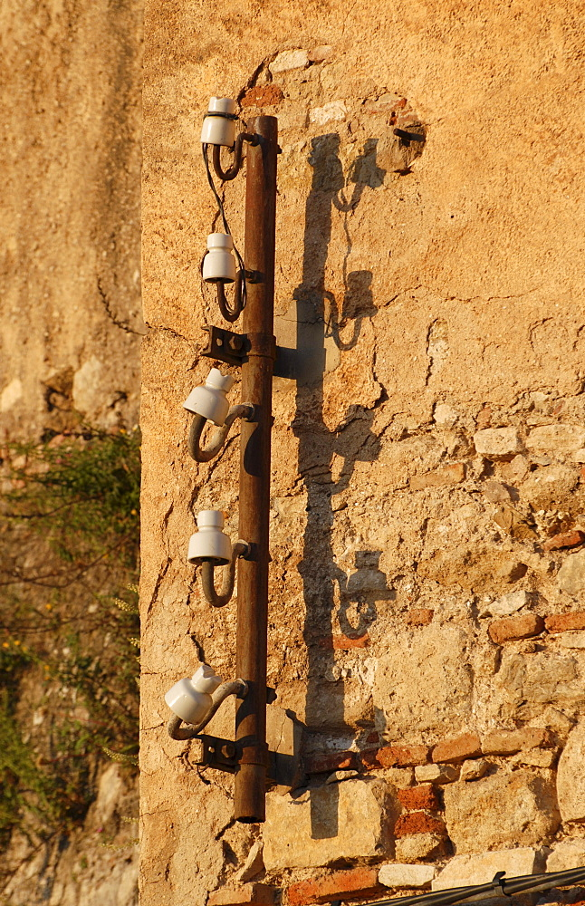 Broken insulators and their shadows in soft morning light, Ronda, Andalusia, Spain, Europe