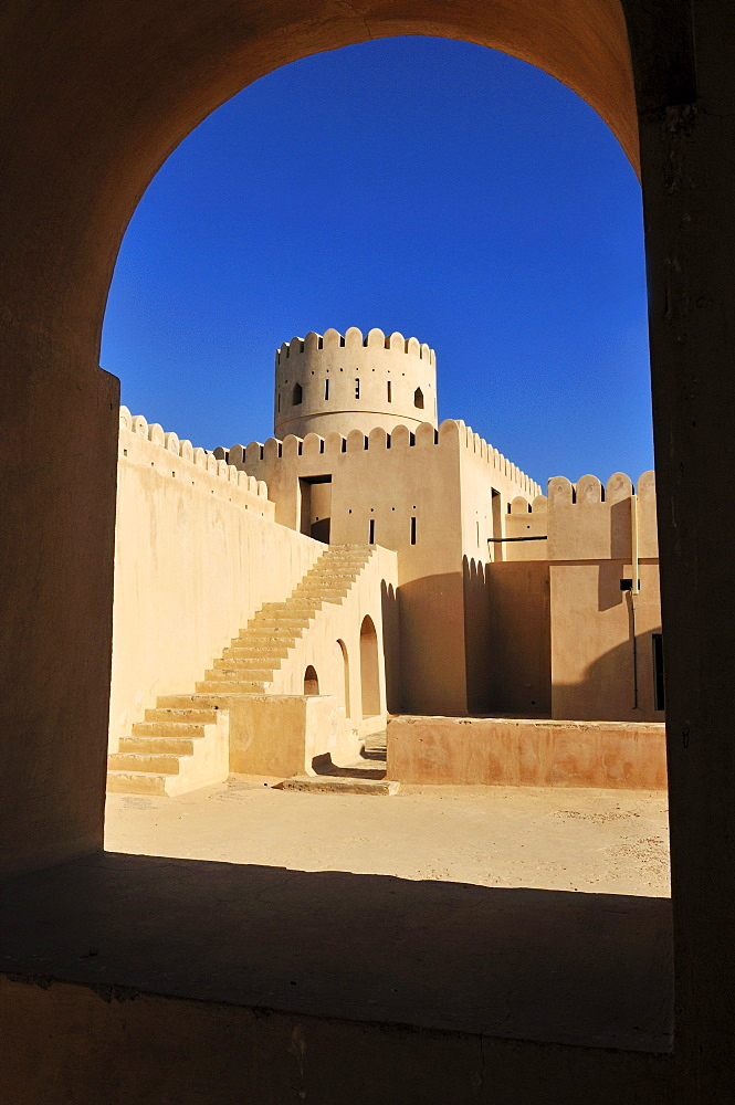 Historic adobe fortification, watchtower of Sunaysilah Castle or Fort in Sur, Al Sharqiya Region, Sultanate of Oman, Arabia, Middle East