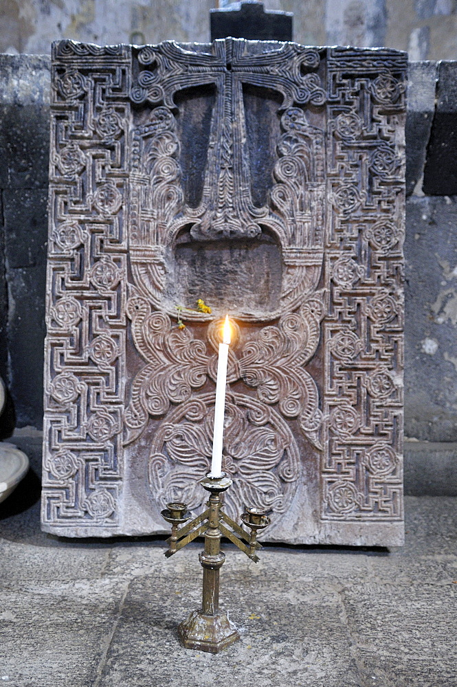 Candleholder and historic cross-stone, khachkar in the Armenian Orthodox church of St. Hripsime, UNESCO World Heritage Site, Echmiadzin, Armenia, Asia