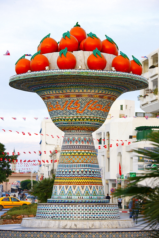 Artificial fruit bowl with oranges, street monument, mosaic, Hammamet, Tunisia, Northern Africa