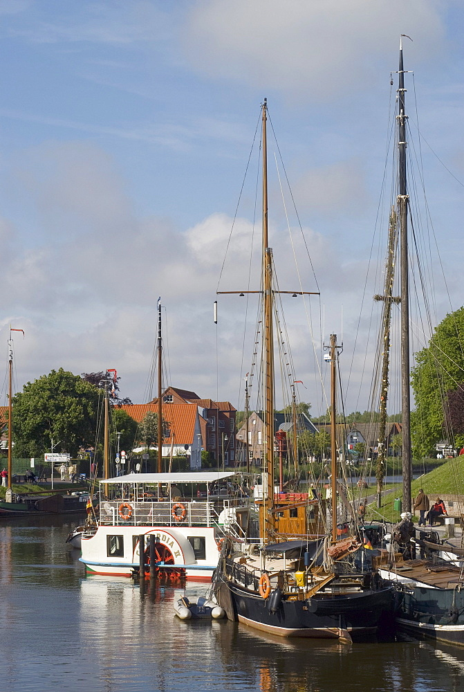 Carolinensiel, paddle steamer Concordia II at the pier in the museum harbor, in the front two historic sailing ships, Wittmund, Nationalpark Wattenmeer, Wadden Sea National Park, East Frisia, Lower Saxony, Germany, Europe
