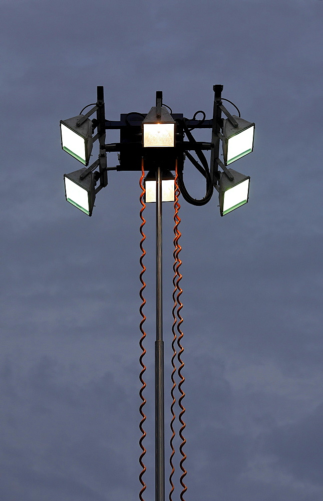 Mobile lamp post in the dusk, lights for operations of the technical emergency service