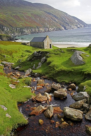 Stone cottage on coast near Keel, Achill Island, County Mayo, Ireland