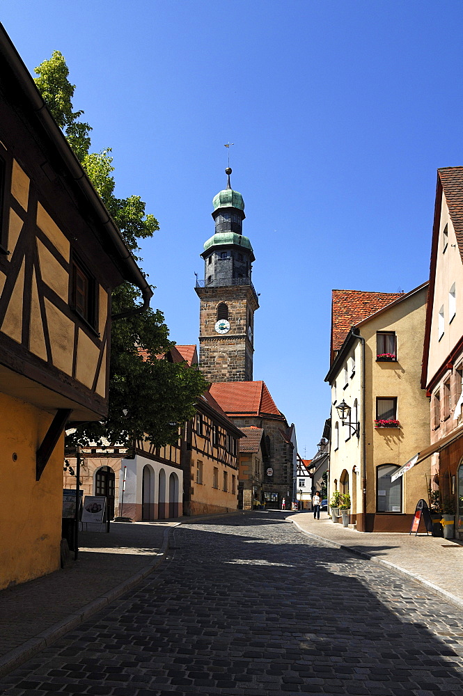Tower of the Nikolai Church, left old Franconian half-timbered house, Lauf an der Pegnitz, Middle Franconia, Bavaria, Germany, Europe