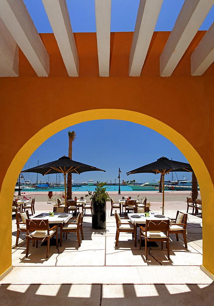 Open air restaurant, parasols, arch, marina, Hurghada, Egypt, Red Sea, Africa