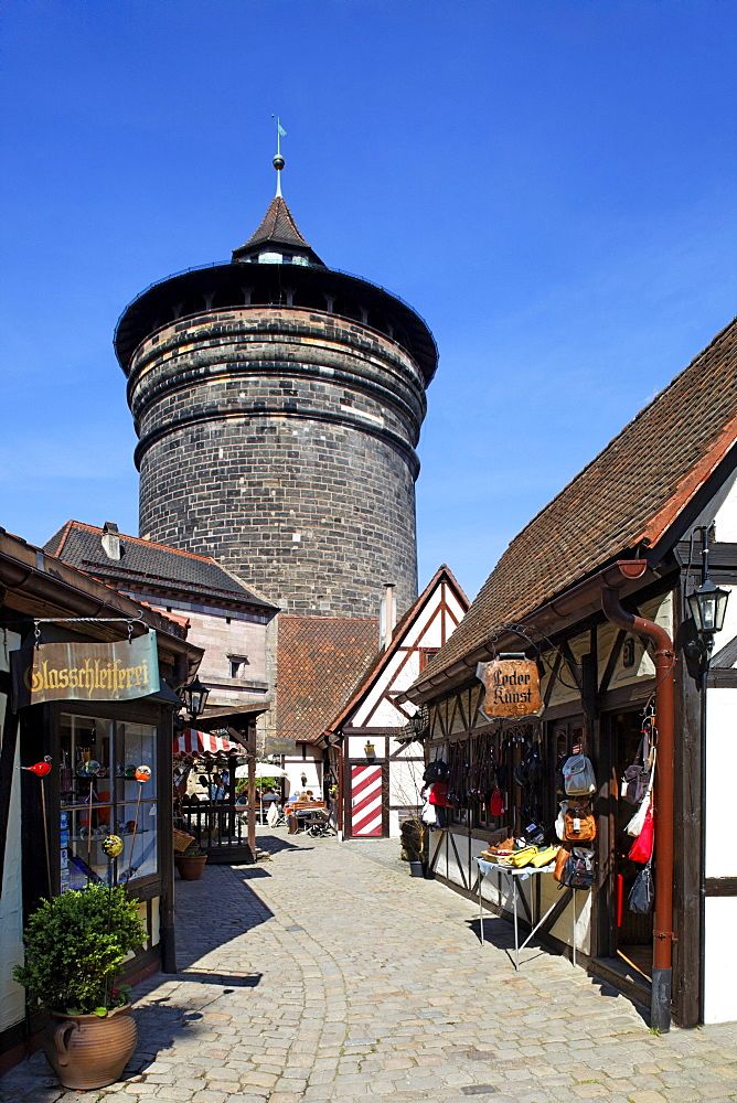 """Craftsmen's yard """"Handwerkerhof"""", glasscutter, leather art, shops, fortified tower, half-timbered houses, historic district, City of Nuremberg, Middle Franconia, Franconia, Bavaria, Germany, Europe"""