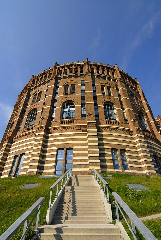 Front facade of the renovated historic Gasometer A in Simmering, Vienna, Austria, Europe