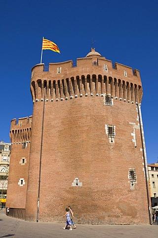 "Catalan flag above the city gate ""Le Castillet"", Perpignan, Pyrenees-Orientales, Roussillon, Languedoc-Roussillon, South France, France"