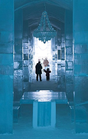 Long hall with a table and a chandelier made of ice, ice hotel of Jukkasjaervi, Lappland, Northern Sweden - 832-235170