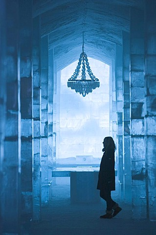 Long hall with a table and a chandelier made of ice, ice hotel of Jukkasjaervi, Lappland, Northern Sweden - 832-235172
