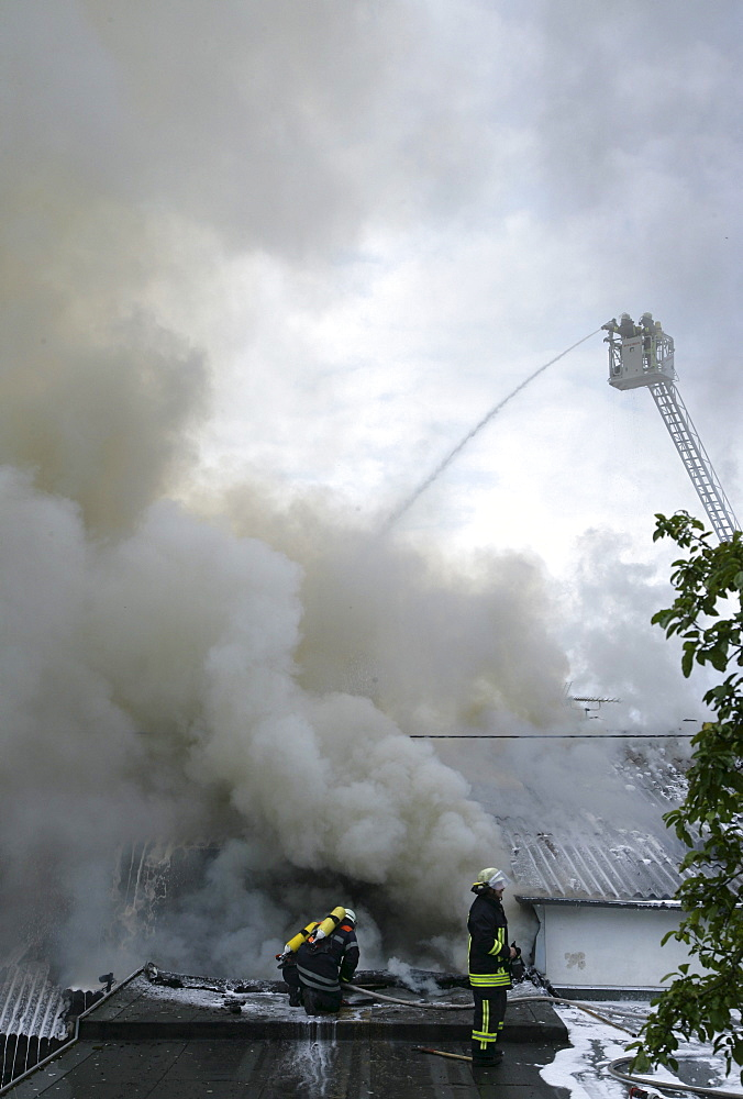 Firefighters fight a blazing fire at a gym and a restaurant in the suburb Arzheim, Koblenz, Rhineland-Palatinate, Germany, Europe