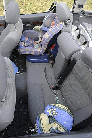 Back seat, child car seat, in accident damaged car