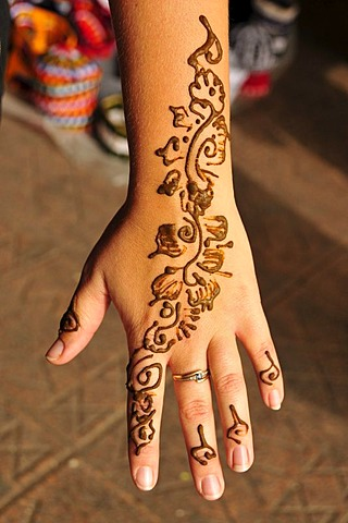 Henna tattoo on the hand of a tourist, Place Djemma el-Fna, Square of the hanged, imposter square, Marrakech, Morocco, Africa - 832-250112