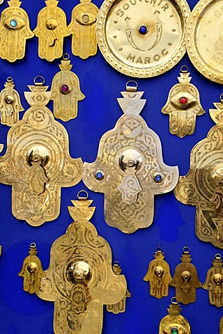 Hamsas or Hands of Fatima, good luck charms, in a souvenir shop at Place Djemma el-Fna, Square of the Hanged, Square of the Jesters, Marrakesh, Morocco, Africa