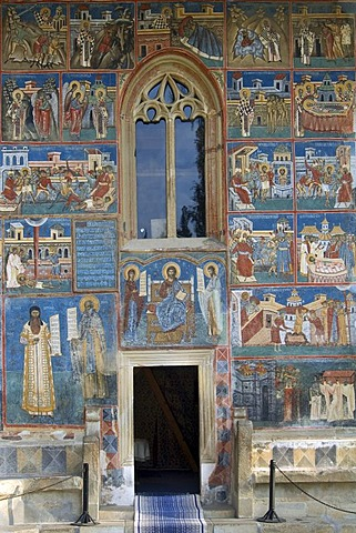 Church of St George of the Voronet Monastry, south facade with scenes from the lives of Sts Nicholas and John the New, UNESCO World Heritage Site, South Bucovina, Moldavia, Romania, Europe