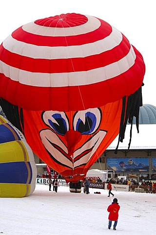 Inflation of a hot-ar balloon, special clown shape, Schroeder fire balloons Clown ss, hot-air balloon, International Balloon Festival, Chateau-d'Oex, Switzerland, Europe