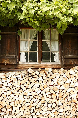 Old Bavarian farmhouse with wooden window shutters, firewood, Linderhof, Bavaria, Germany, Europe