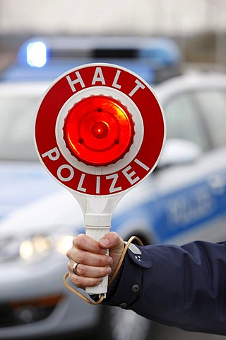Police stop sign for stopping cars, Duesseldorf, North Rhine-Westphalia, Germany, Europe