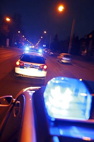 German police cars, blue design, in action with flashing sirens