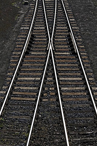Railway tracks with a switch joining two tracks into one, view from above