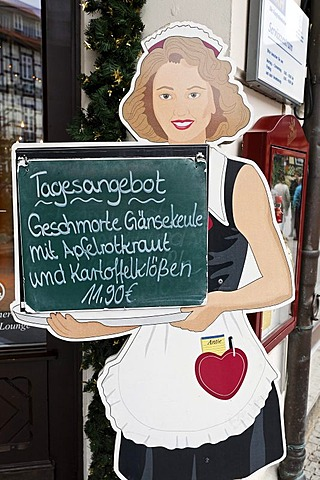 Cardboard waitress displaying the menu of the day, braised leg of goose, Wernigerode, Harz, Saxony-Anhalt, Germany, Europe