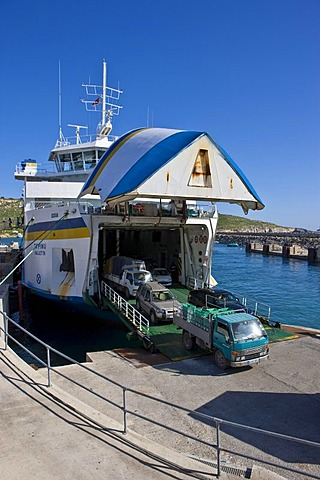 Ferry from Malta docking in the Mgarr port of Gozo and unloading vehicles, Mgarr, Gozo, Malta, Europe