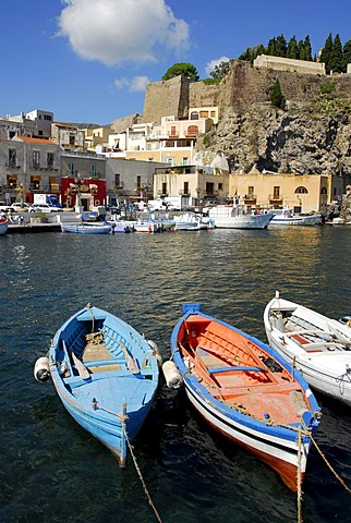 Small fishing boats in the port of Marina Corta in front of the castle hill in the city of Lipari on Lipari Island, Aeolian or Lipari Islands, Tyrrhenian Sea, South Italy, Italy, Europe