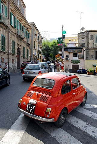 Red Fiat 500 in the historic centre of Tropea, Vibo Valentia, Calabria, South Italy, Europe