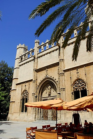 Terrace with sun shades in front of the medieval entrance portal of Sa Llotja, former maritime trade stock exchange, used today for exhibitions of art and culture, facade in the Catalonian gothic style, historic city centre, Ciutat Antiga, Palma de Mallor