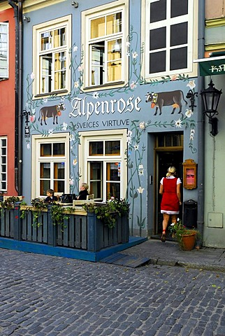 Alpenrose bar cafe restaurant terrace in the Jauniela street in the historic center Vecriga, mural painting with flowers and cows, Riga, Latvia, Baltic States, Northeast Europe